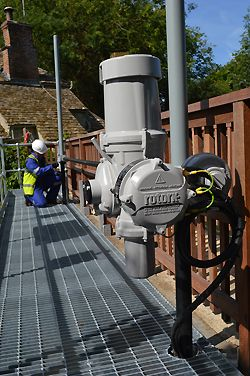 Installation nearing completion on the new walkway platform; the IQ3 actuator in the foreground is fitted with its vandal-proof cover.