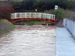 The River Mwldan in danger of over-topping the weir in 2014, before the automation scheme was installed.